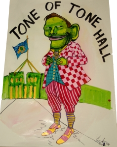 Proudly standing in front of his very own Hall, Tone has dressed well for the occasion. Wearing his favourite racing colours cleverly disguised as tasteful attire, including shoes handmade in Barcelona, our hero thinks of new ways to save Our Country.